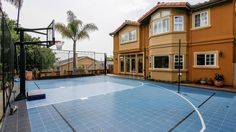 The five-bedroom home in Manhattan Beach features a basketball half-court and a swimming pool