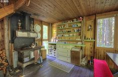 Love this old cast iron stove!  Off Grid Tiny Cabin in Rhododendron, OR For Sale