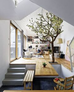 A tree in the house? They must be waiting for godot. I wonder if it is real. I like the idea but would hate to clean up the leaves during the fall.