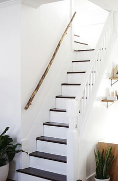 Love the simple wooden railing up the stairs. Looks OLD! | @themerrythought