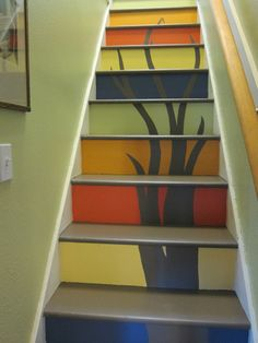 I want to redo carpeted stairs- Painting or tiling the risers on steps is a neato idea!