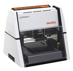 """Roland's New CNC Hobby Mill: """"Superficially, it looks kind of like a Prusa Mendel with a rotary cutting tool in place of the extruder. The top of the """"A frame"""" actually folds over so the substrate (itself taped to a spoil board) can be taped to the work platform. The product is not yet available in the US, but launched in Japan in early October."""""""