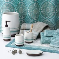 Got the soap pump, toothbrush holder, and the patterned towels. Thinking about getting a shower curtain and making it into a valance.