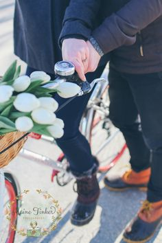 engagement session with a bike and tulips.
