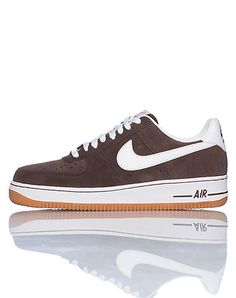 NIKE+Low+top+men's+sneaker+Lace+up+closure+Padded+tongue+with+NIKE+logo+Signature+swoosh+on+side+of+shoe+Cushioned+sole+for+comfort+Suede+material