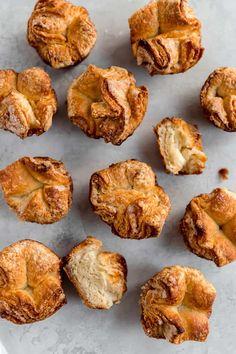 An overhead shot of kouign-amann pastries. Butter Block, Kouign Amann, Best Butter, Sticky Buns, Muffin Tins, Instant Yeast, Recipe Notes, French Pastries