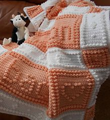 """This crocheted baby blanket is an original design that is easy to complete. The blanket when finished reads, """"I love you to the moon and back."""""""