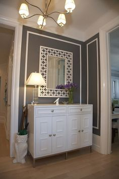 I'm over all the white, but I like the grey/white combo on the wall. Throw in some purple or aqua, and I think I'm in. Maybe for the formal living room? #color #living_room #grey #gray #neutrals #white #molding