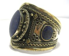 This Afghan Kuchi Tribal Bracelet Cuff is originally manufactured in Afghanistan by craftsmen with years old experience, which is transferred from generations to generations in the Afghan Kuchi Tribe.