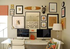 His and hers shared office. Love the variation of picture sizes on the wall and the skateboard deck.