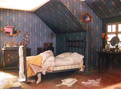 dollhouse attic bedroom. I love that it's not tidy it makes it even more realistic.