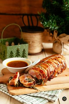 Bacon-Wrapped Pork Loin Stuffed with Spinach and Goat Cheese