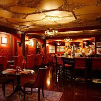 Situated directly across Lafayette Park from the White House in the historic Hay-Adams Hotel, Off the Record's location alone guarantees its position as one of Washington's most important cocktail bars. There's a dignified air, intensified by the pressed tin ceilings, the glass cabinet holding bottles behind the oval bar, and the blood red walls, although the mood is lightened somewhat by the dozens of political caricatures on display, donated by editorial cartoonist and author Art Wood…