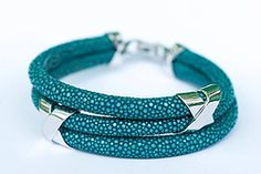 Turquoise Stingray Leather Bracelet 150 USD. This eye-catching turquoise stingray triple leather bracelet with rhodium-plated sterling silver decorations will attract everyone's attention. Be different... #jewelry #leatherbracelet #phantom #stingraybracelet #silver #handcrafted #beautiful #bracelet #fashion #musthave #leather