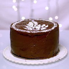 Divergent fans, Insurgent hits theaters today, and do we have one lush chocolate cake recipe for you! Start with the chocolate cake recipe of your choice (this video shows off our chocolate cake with chocolate buttercream), and then learn how to make a Divergent-themed powdered-sugar stencil. Do you choose Dauntless?