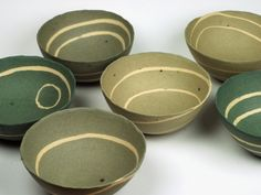 Charlotte Jones  Pebble bowls 50h x 110w mm  Thrown small bowls in coloured stoneware clay. Cut when leather hard, coils of white clay added and bowl reasembled. Pinched and burnished.
