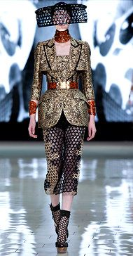 by Sarah Burton for Alexander McQueen | A jacquard jacket with tracings of organza and a honeycomb-net skirt