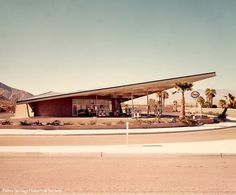 Marking the entrance to the city of Palm Springs, the Tramway Gas Station provides a hint of the architectural innovation that lay ahead. Designed by architect Albert Frey with Robson Chambers in 1965, the distinctive roof structure is a hyperbolic paraboloid of steel I-beams and corrugated metal roofing, a design that allows minimal need for support columns. The station has since been renovated with Frey's collaboration.  Photo by Julius Shulman.