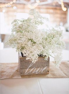 Another great example of Baby's Breath in a chic wedding. Simple wooden boxes with bouquets of Baby's Breath make for elegant and eye-catching arrangements - not to mention affordable and easy to assemble! I definitely want baby's breath in my wedding Vintage Wedding Centerpieces, Diy Centerpieces, Wedding Table, Wedding Decorations, Wedding Rustic, Wedding Vintage, Wedding Country, Vintage Diy, Vintage Table