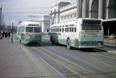 "DC Transit PCC and GM ""Old Look"" Bus (on route 20) (probably 1960 or later after all routes that used overhead wires were converted to bus operation)."