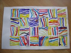 Oeuvre collective : chaque enfant peint ses propres lignes sur le carré qui lui est donné.