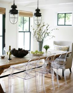 clear chairs, rustic table, and his and her slipcovered chairs