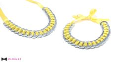 Inox washer necklace with yellow satin ribbon.