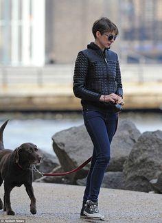 Devastated: Anne looks solemn walking her chocolate labrador, Esmeralda in New York City on Tuesday