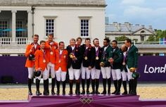 Equestrian team results:  Great Britain (C) celebrates with their gold medals, the Netherlands (L) with their silver medals and Saudi Arabia (R) with their bronze medals