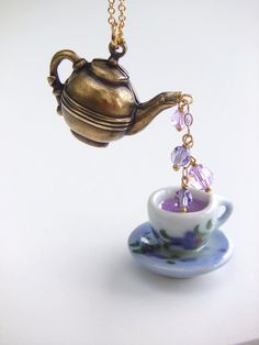 Brass and Gold Teapot/Cup, Lavender Tea Pendant Necklace, Jewelry Fashion, Gift for Her. $30.00, via Etsy.
