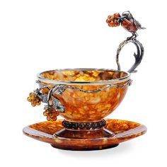 """Amber Tea Set """"Robin"""". Isn't this exquisite? Made from amber -- how talented people are to make something this lovely from basically a stone."""
