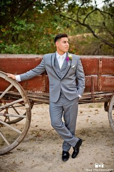 Vintage glam wedding with the groom in a grey suit with black detail on the lapel