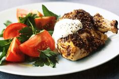 Everyone will love these chicken breasts with Middle Eastern spices and a light tomato and herb salad on the side.