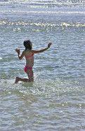 Cavorting in rippled waters; Glenelg, South Australia, Australia.  January 2014.