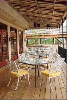 Porch dining at Mirbeau Inn & Spa at The Pinehills. www.mirbeau.com/pinehills