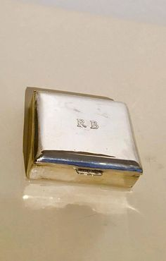 """925 Silver box, Bogota, Colombia, 20th century, maker`s mark """"ATN"""" with crossed hammers within a shield-shaped cartouche.  Box with wood inside, as you see on the pictures, with B.R engraved on the top.  Rectangular box, pure, simple box, marked , pure silver.  Mesures : 9 cm x 7,5 cm x 2 cm H and 143 grs, included wood. 
