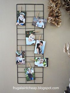 Alternative way to hang photo prints using a metal grid and clothespins.