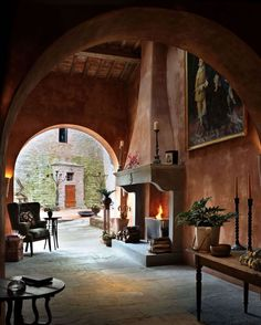 The magnificent fireplace and cosy vibes of hotel @reschio are a good reminder that Italy isn't all sunshine and swimming pools. The building is an Umbrian castle 1,000 years old and I love how they've embraced its quiet grandeur while still keeping things homely. Via @galeriemagazine