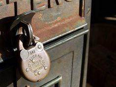 Padlock on an old mailbox by Adventurer Dustin Holmes, via Flickr