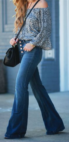 Florida fashion blogger styles a 70's inspired outfit with an off the shoulder flowy top paired with high waisted flared jeans and layered necklace, perfect for fall transition