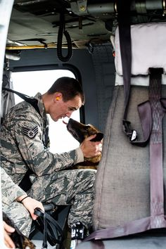 Tech Sgt. Andrew Montgomery, an Air Force military working dog handler, comforts his dog Diesel inside an Army UH-60 Black Hawk helicopter operated by A Company, 3rd Battalion, 142nd Assault Helicopter Company, 42nd Combat Aviation Brigade, during a familiarization exercise for the dogs on Jan. 10, 2014, somewhere in southwest Asia. The working dogs can be transported by helicopter quickly and efficiently to wherever they're needed once they become comfortable with the aircraft.