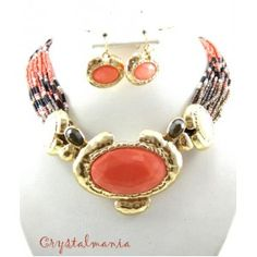 Set de collar y aretes de chakira en color negro con naranja estilo 30058