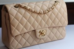 Chanel Medium Classic Flap (either Single or Double Flap), Beige/Cream? in Gold Hardware. Caviar Leather