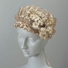 Hat. French, 1800–05. Silk net, silk satin ribbon, and fabric and wire flower trim - in the Museum of Fine Arts Boston.