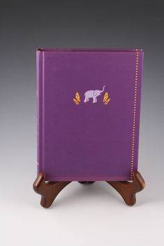 This purple journal features an elephant on the cover, with a row of goldenrod diamonds on the right side. It is the perfect journal for your