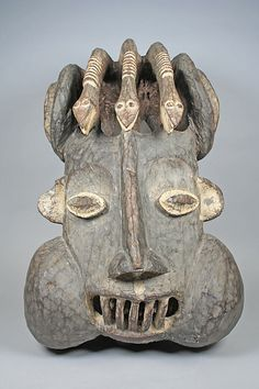 Helmet Mask: Snakes Date: 19th century Geography: Cameroon, Western Grassfields, West Province Culture: Bamileke Medium: Wood, kaolin