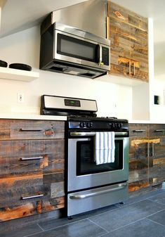Reclaimed weathered wood overhaul on kitchen cabinetry