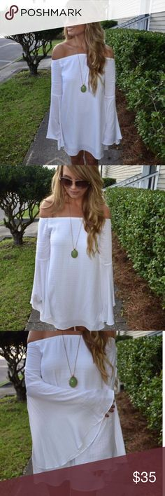 White off shoulder dress with bell sleeves The perfect little white dress. This off the shoulder dress features bell sleeves and a full lining.  -100% Rayon  -100% Polyester  -wearing size small Dresses Mini