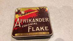 VINTAGE 'Afrikander Colonial Flake' TOBACCO TIN. VGC. 8.5cm×8cm