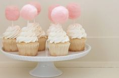 lots of vanilla icing and a pink cotton candy cupcake topper!  Love these!  ~  we ❤ this! moncheribridals.com